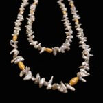 """Barbara Heinrich, 35"""" Long Akoya Pearl necklace with small grey pearls, textured rice spacers and a toggle clasp"""
